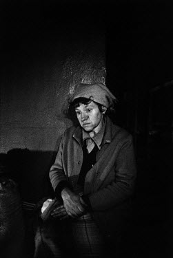 In a shelter, a Russian citizen of Grozny mourns her husband. He died of a heart attack four days before this picture was taken, having lived through a year of war.