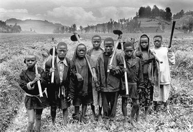 Orphaned peasant children using hoes to prepare the soil on farmland which had been abandoned during the civil war.