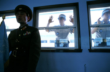A North Korean soldier being psyched out by South Korean soldiers at the Demilitarized Zone (DMZ).