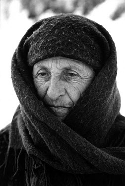 An old woman among a group of refugees from Chechnya in the village of Duisi.
