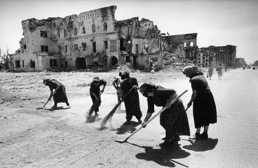 A women's work brigade paid by the Russian federal authorities to sweep the streets of the war-ravaged city centre.