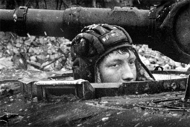 A young Russian soldier in his tank.
