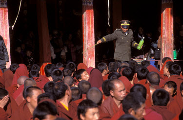 Chinese policeman controlling a crowd at Nechung Monastery.