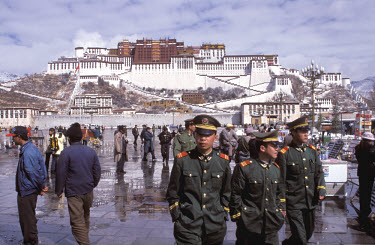 Chinese troops in front of the Potala Palace.