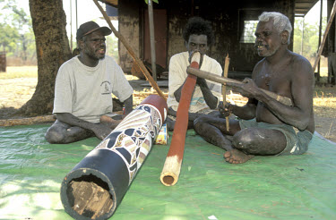 Andrew Margululu and friends with their instruments at his outstation. They are members of the 750-strong Ramingining community, of which a third have chosen to live on outstations in their own countr...