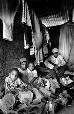 AIDS orphans in their home in the Kibera slum. They survive by scavenging in a dump for anything of value.