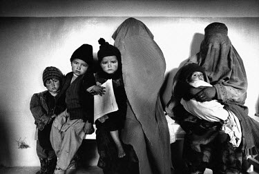 Mothers (still wearing the burqa, despite the fall of the Taliban) bringing their children to the Medecins Sans Frontieres (MSF) hospital for consultation.
