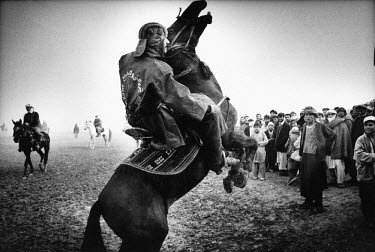 Buzkashi is Afghanistan's national sport. Literally translated as ^goat grabbing^, it is played by two teams of men on horseback. They battle for control of a headless goat's carcass, with the objecti...