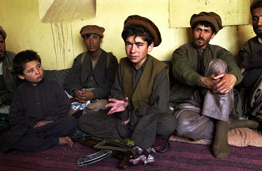 Hammayun, 15, a teenage Northern Alliance warlord in Haq Bullaq, surrounded by bodyguards and soldiers.