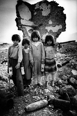 Young Kurdish children collect copper and aluminium by chopping it from unexploded ordnance in an old ammunition bunker. They sell it for ten cents per kilo. Millions of landmines litter the former fr...