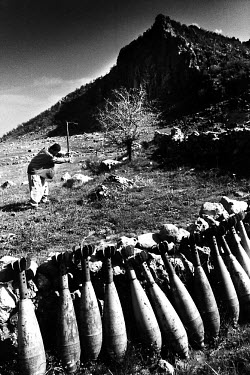 A Kurdish farmer working in his field. Every now and then, he unearths live mortar grenades. Millions of landmines and unexploded ordnance litter the former front line in the Iran/Iraq war, still kill...