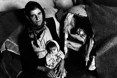 A Kurdish woman with her children. She has barely enough money to feed them. Her husband was killed during the Kurdish uprising after the Gulf war. Kurdistan.