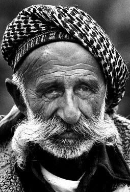 Kurdish man who lost his wits after his whole family was killed in front of his eyes during the Kurdish uprising against President Saddam Hussein. He is looked after by other villagers. Kurdistan.