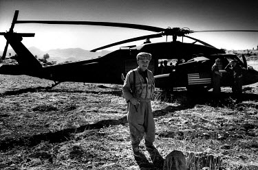 A Kurdish fighter guards an American Black Hawk helicopter. In the aftermath of the Gulf War, the US and its allies created a no-fly zone over Northern Iraq. The helicopter was undertaking a mission u...