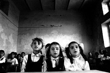 Kurdish children attending primary school. Due to the United Nations embargo against Iraq and an Iraqi blockade against Kurdistan, the economic situation in the region was terrible. The school was bei...
