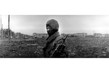 A Russian special forces member surveys the wasteland that is now central Grozny. In this spot stood a hotel, government buildings and residential apartments. Russians forces destroyed the area, calle...