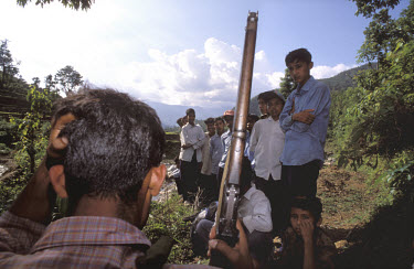 Maoist guerilla fighters and school kids.