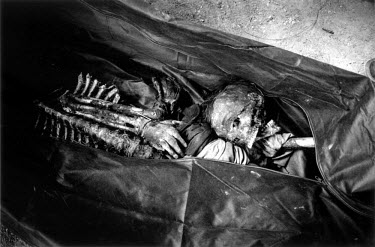 Human remains with cords tied around the wrists, discovered in a mass grave in Grozny in February 2001. After much public pressure the Russians disclosed the location of the grave on the grounds of th...
