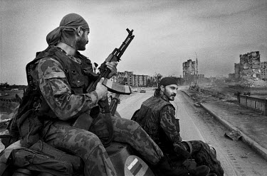 Russian contract soldiers patrol the ruined centre of Grozny. They work on three month contracts and make the equivalent of $500 per month.