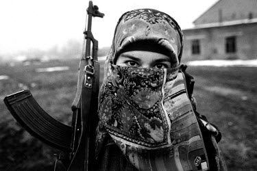 Female Chechen rebel fighter. The veil is not a Chechen tradition - she wears it as a personal choice.