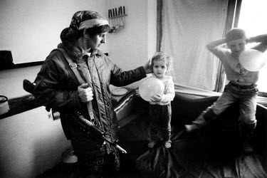 A mother shares a tender goodbye with one of her four children before going out to help her husband, a Chechen rebel fighter, who was killed two months later in heavy fighting with Russian forces who...