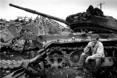 Victor, a Russian man who was born in Grozny, sits beside a destroyed Russian tank and drinks a shot of vodka to remember the crew that died inside. The number of ethnic Russians in Grozny has dramati...