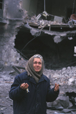 A Russian woman curses President Yeltsin after a Russian bombing attack which killed her mother.  She is holding the keys to her destroyed house.  The irony of Grozny is that many of the civilians lef...
