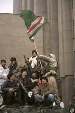 Chechen soldiers wave their flag outside the Presidential palace in celebration of their defeat of the Russian army over New Year. ~In December 1994 Russian troops entered Chechnya in an attempt to qu...