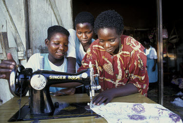 AIDS orphans taught sewing at a skills training class.