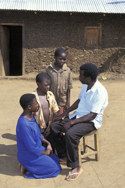 Remegio Mayanje counselling AIDS orphans.