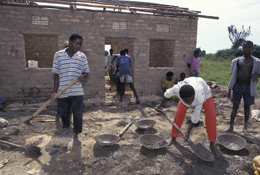 AIDS orphans being trained to build homes for themselves, in a project supported by Save the Children.