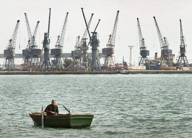 Ramazan Durmus waits for a fare in his boat in the southern port of Mersin. Customers are scarce since the embargo against Iraq means that few ships dock here.
