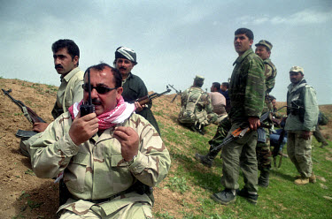 Kurdish commander of the 17th army Serbest Baberi directs his peshmerga fighters. Together with US special forces, they attacked Iraqi positions in the village of Khazar. US and British troops invade...
