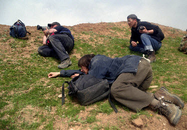 Journalists take cover during an Iraqi mortar attack. They were travelling with Kurdish peshmerga fighters and US special forces who were attacking Iraqi positions in the village of Khazar. US and Br...