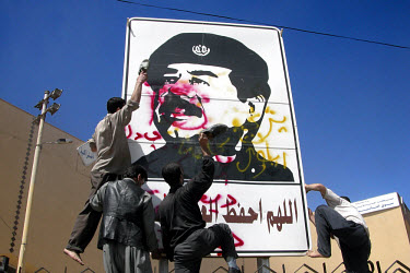 Kurds beat a picture of Saddam Hussein with their shoes, on the day that Kirkuk fell. US and British troops invaded Iraq on 20th March with the aim of overthrowing the regime of Saddam Hussein. By the...