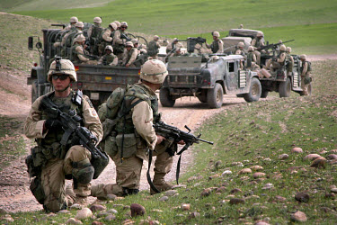 American soldiers, paratroopers of the 173rd Airborne brigade, pass local shepherds as they make their way to the front line. US and British troops invaded Iraq on 20th March with the aim of overthrow...