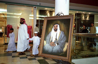 Saudi family alongside a portrait of Sheikh Zayed bin Sultan al-Nahyan in a shopping centre. Renowned as the father of the nation, he was president from the UAE's formation in 1971 until his death in...
