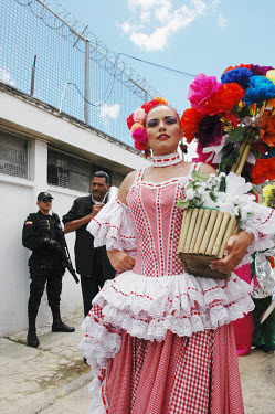 A competitor in the beauty pageant held at the Buen Pastor women's prison. Seven contestants, ranging from assassins to thieves, left wing guerillas to right wing paramilitaries, vied for the beauty q...