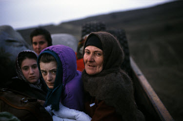Chechen civilians flee the village of Bamut over the mountains, after it came under attack by Russian forces in winter.