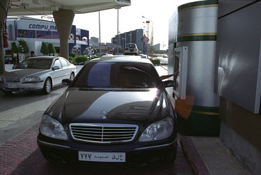 Mercedes driver using a drive-in bank machine (ATM).