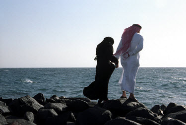 A couple by the shores of the Red Sea near Jeddah. Married couples can be seen together in public, but not unmarried couples or unaccompanied women.
