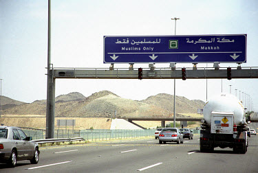 Motorway with a sign post for Mecca, Islam's holiest city. Only Muslims are allowed into Mecca, so the sign diverts non-Muslims in another direction.