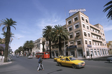 Taxi on Independence Avenue, beneath a billboard for the Alitalia airline, a sign of the remaining influence of Eritrea's Italian former colonists.