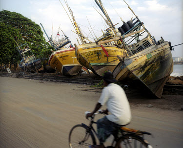 Fishing boats swept up on to the coastal road by the force of the tsunami which struck South Asia on 26/12/2004. An underwater earthquake measuring 9 on the Richter scale triggered a series of tidal w...