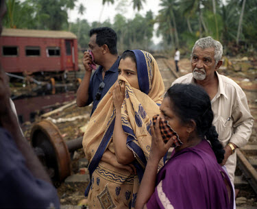 Families gather to identify the bodies of relatives found in the wreckage of a coastal train, the 'Queen of the Sea', which was derailed by the tsunami which struck South Asia on 26/12/2004. Over 1,00...