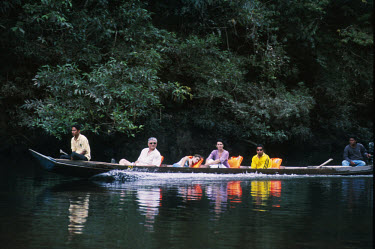 Tourists taking a trip on a river boat in Taman Negara National Park. The pristine primary rainforest here is claimed to be the oldest in the world, having existed largely as it is for the past 130 mi...