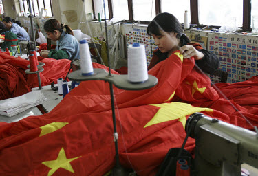 Workers putting the finishing touches to Chinese flags at the state-owned Shanghai Flag Factory. China manufactures the majority of the world's flags.