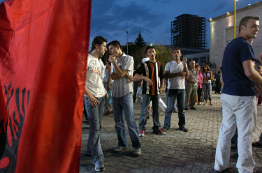 Youths wait for the beginning of a Socialist Party rally. Parliamentary elections were held two days later.