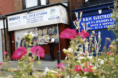 A police officer standing guard outside the Hamara youth centre in the Beeston Hill area, which was being searched as part of the investigation into the terrorist attack on London on the 7th of July....