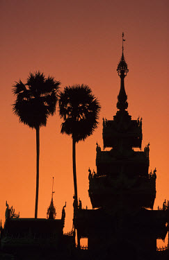 Western entrance of Shwedagon Buddhist Pagoda at sunset.
